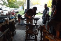 Master wheelwright Phill Gregson and Blacksmith Clark Martinek